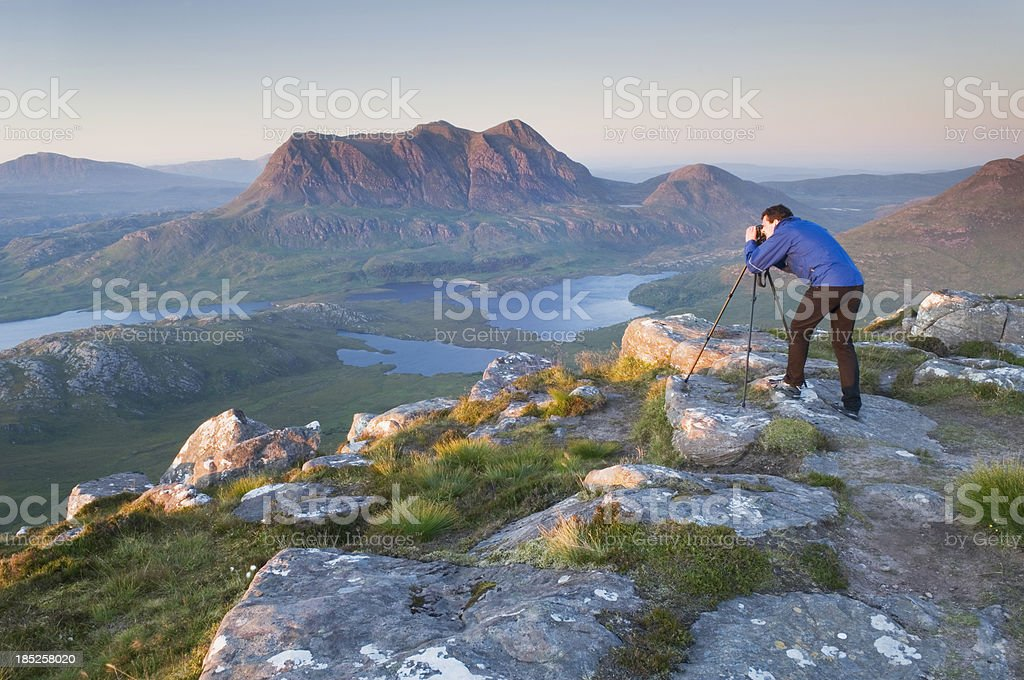 Photographer on mountain top stock photo