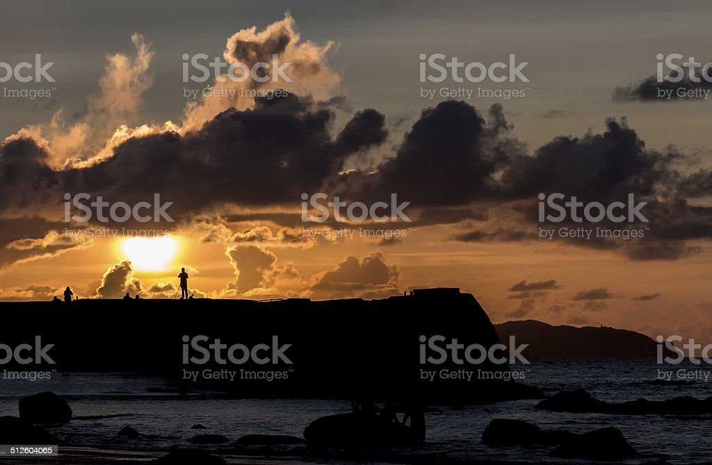 Photographer on pier at sunset royalty-free stock photo