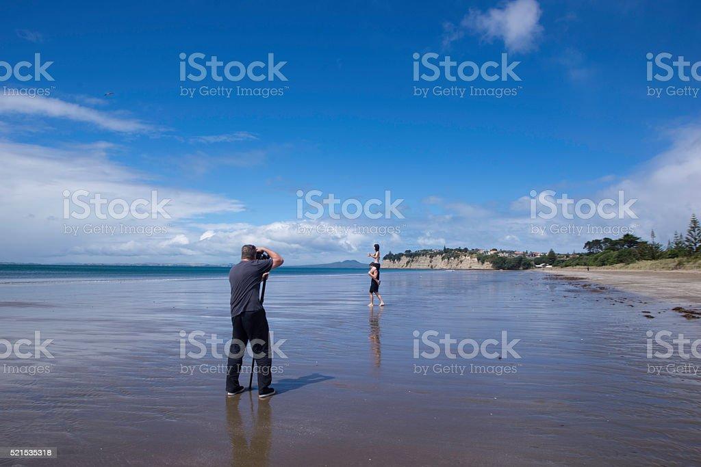 Photographer on the beach stock photo