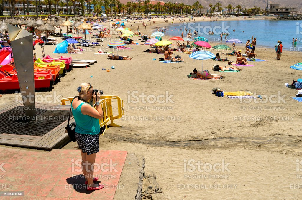 Photographer on the beach taking photographs stock photo