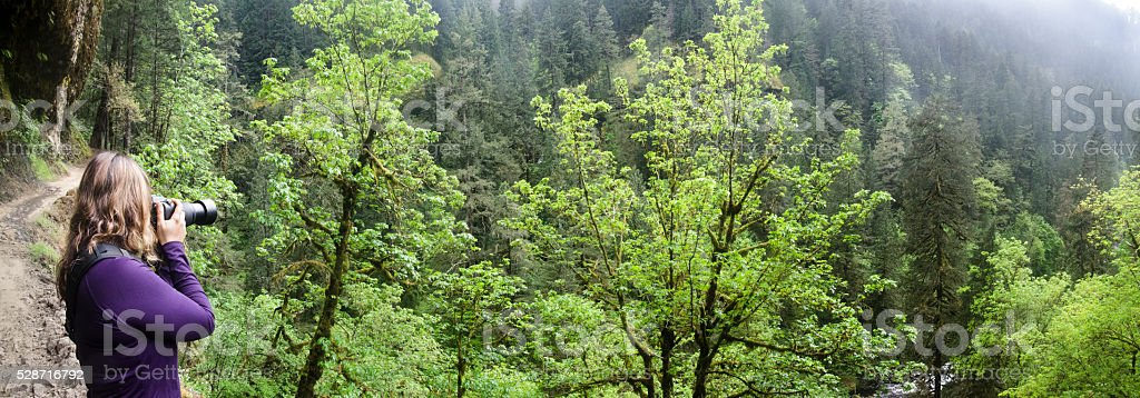 Photographer on the Eagle Creek Trail Panorama stock photo