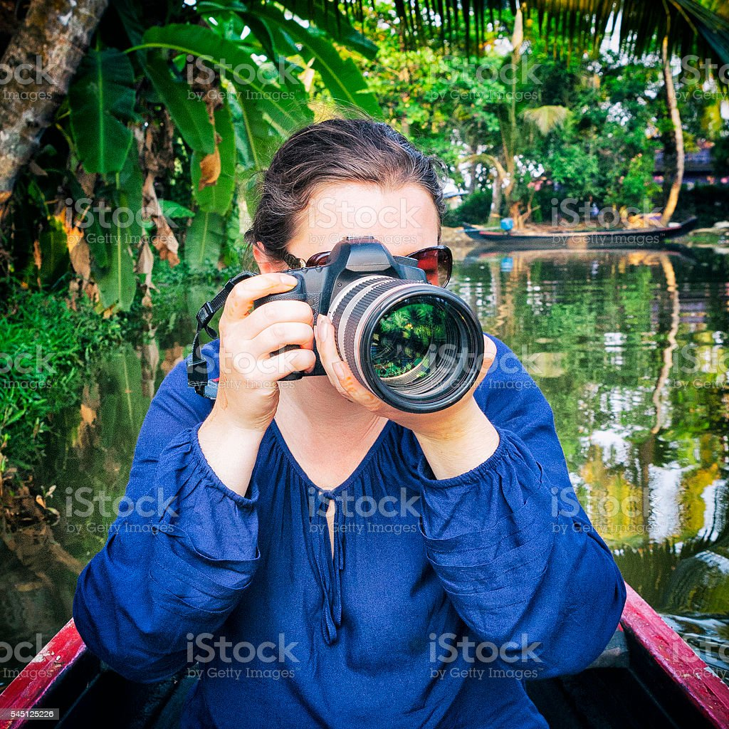 Photographer on the Kerala Backwaters in India stock photo