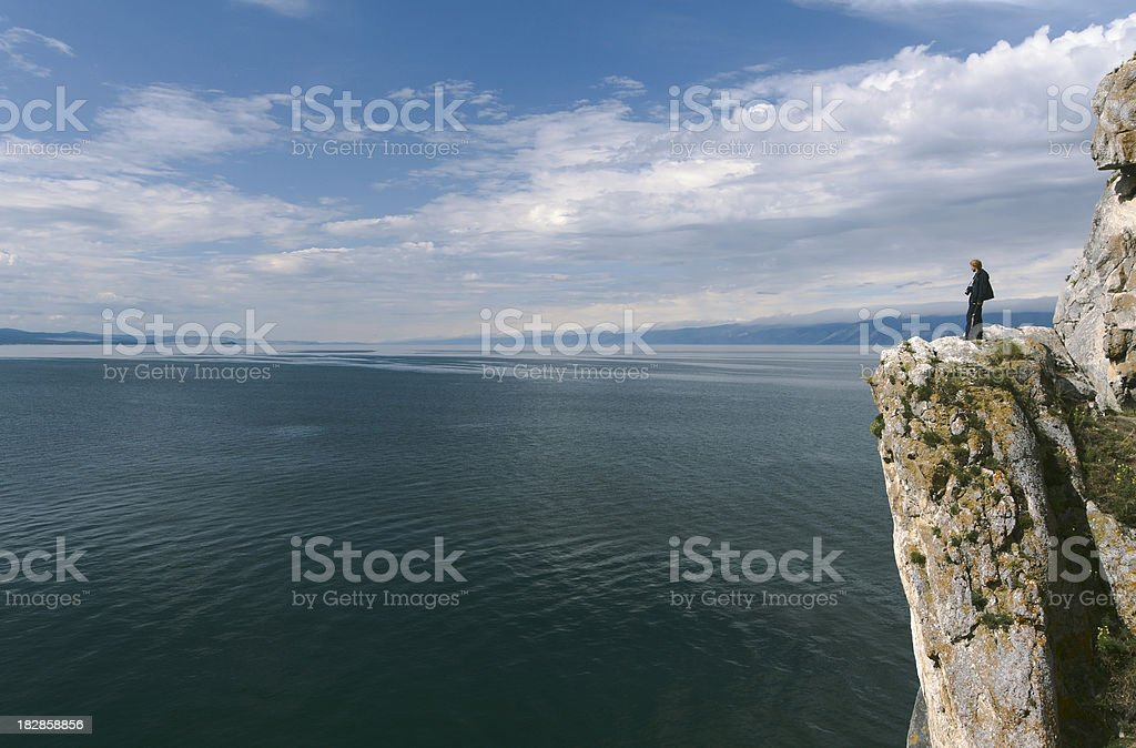 Photographer on the rock royalty-free stock photo