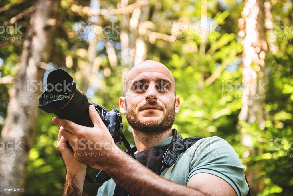 photographer on the woods stock photo