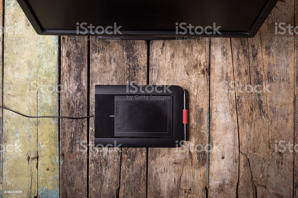 Photographer or designer workplace at wooden desk stock photo