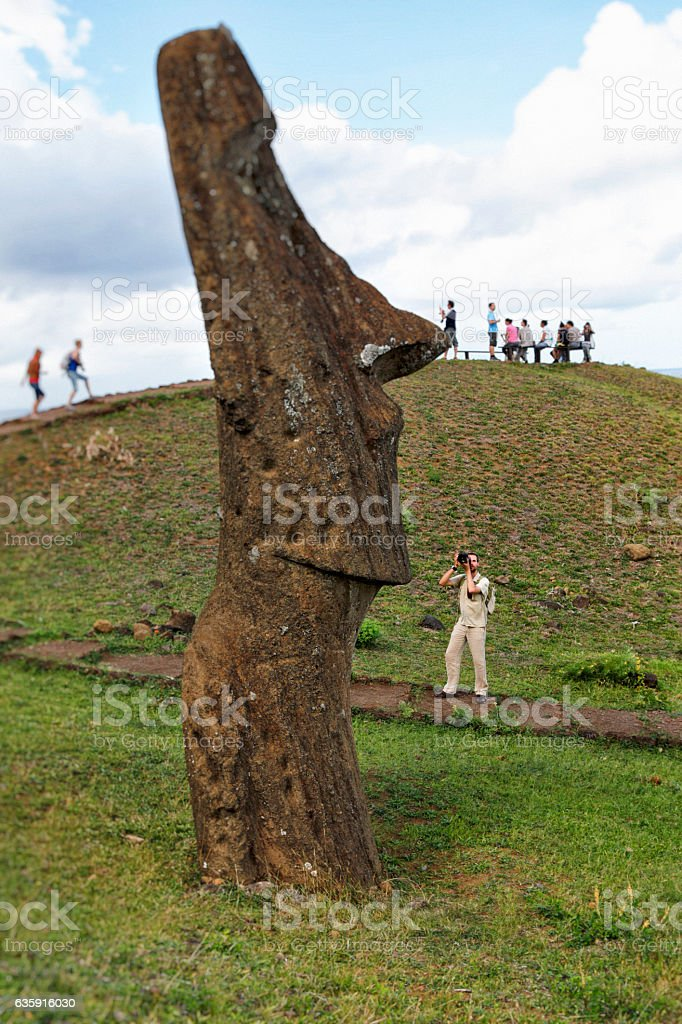 Photographer Photographing Moai at Rano Raraku, Easter Island, Chile stock photo
