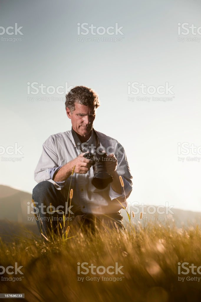 Photographer Reviewing the Image Vertical royalty-free stock photo