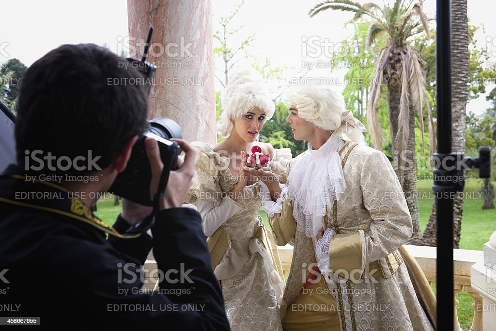 Photographer shooting models on location in Cannes, France stock photo