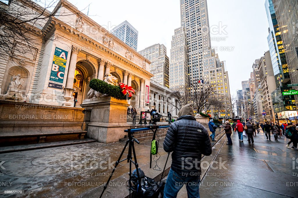 Photographer shooting near New York Public Library stock photo