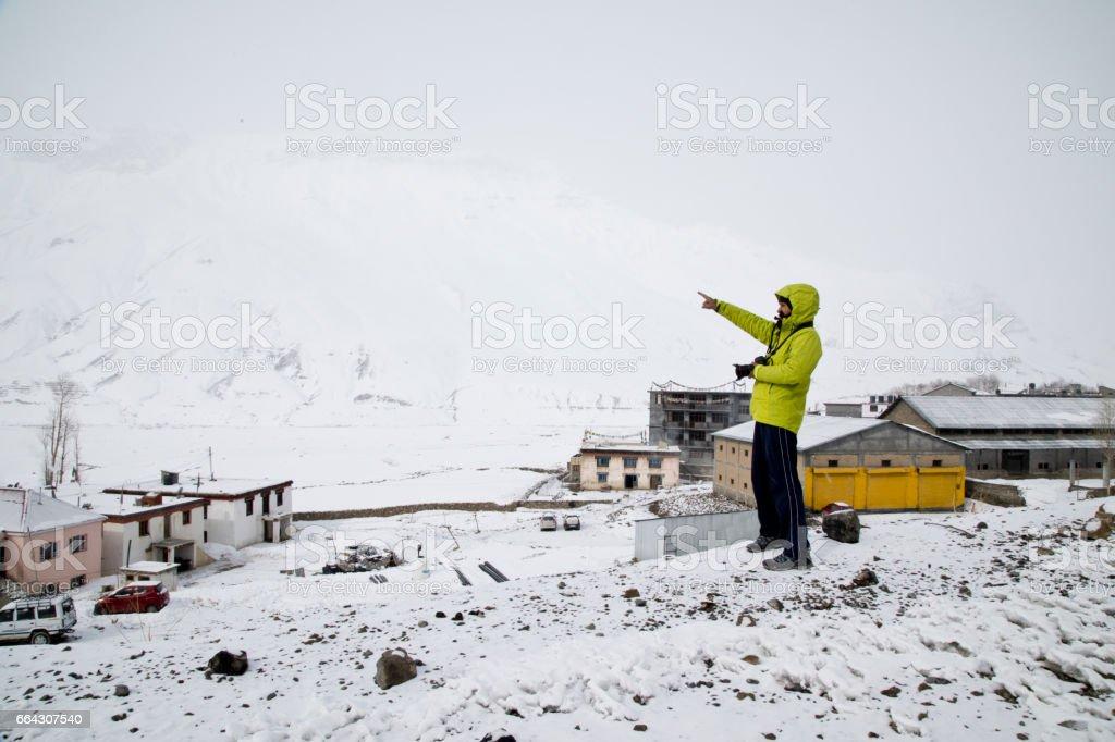 Photographer shooting snowcapped Himalayan mountain stock photo