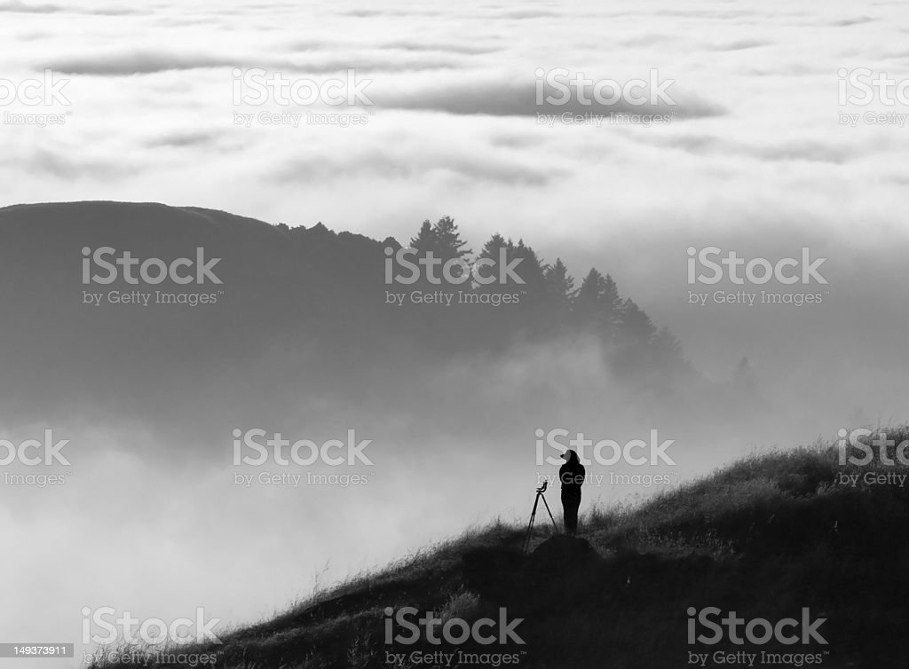 Photographer silhouette over fog royalty-free stock photo
