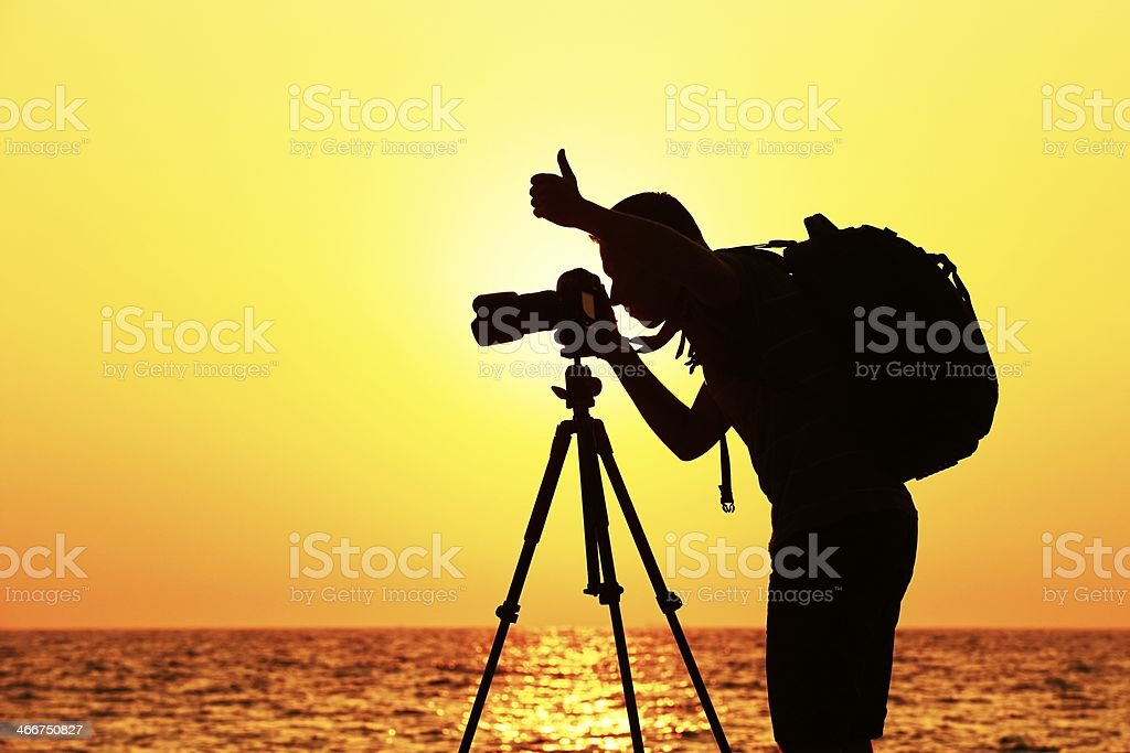 Photographer silhouette with camera stock photo