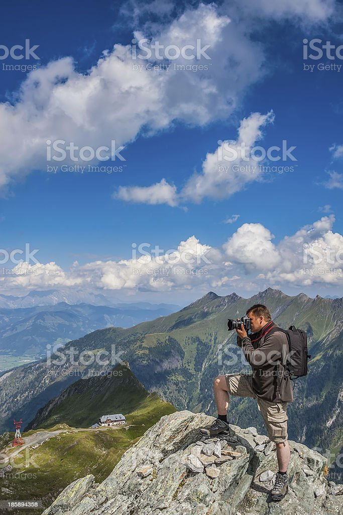 Photographer takes pictures in the mountains royalty-free stock photo