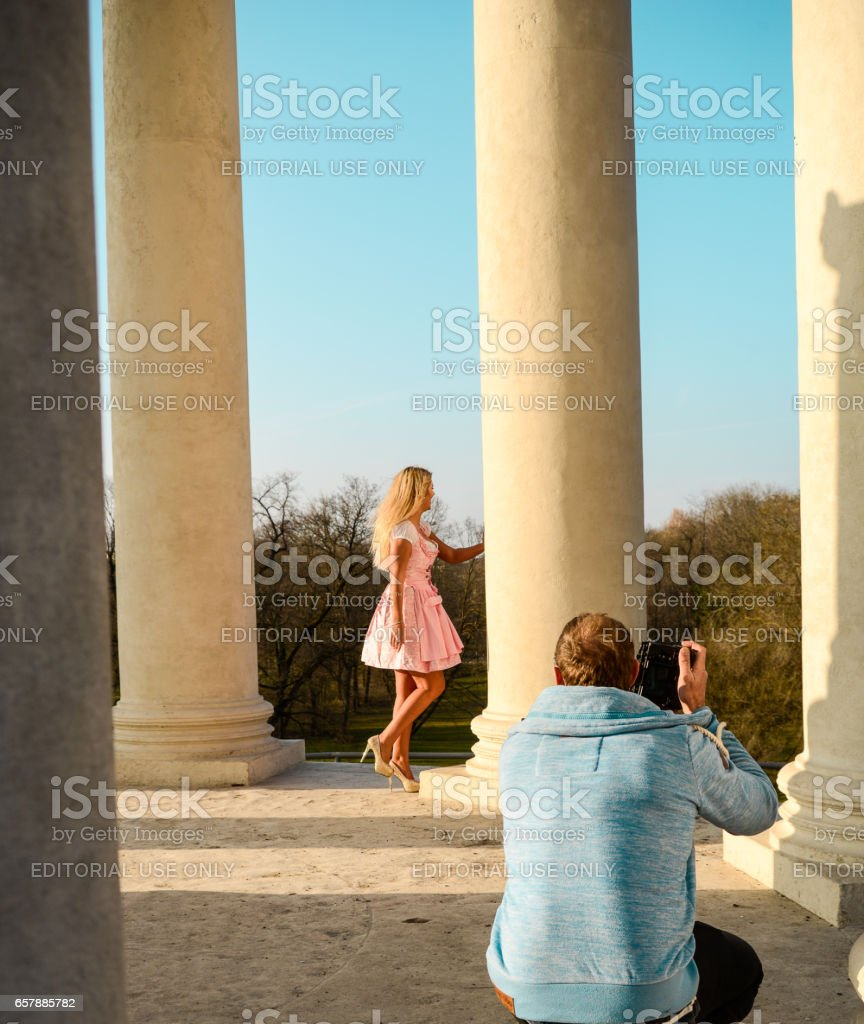 A photographer takes pictures of a model stock photo