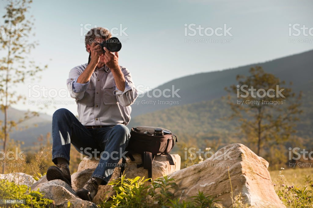 Photographer Taking a Photograph royalty-free stock photo