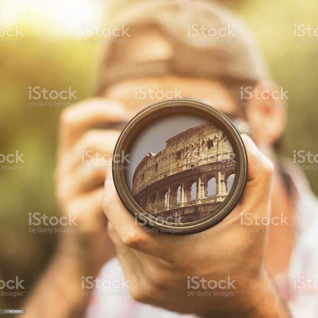 Photographer taking a picture in rome at colisuem royalty-free stock photo