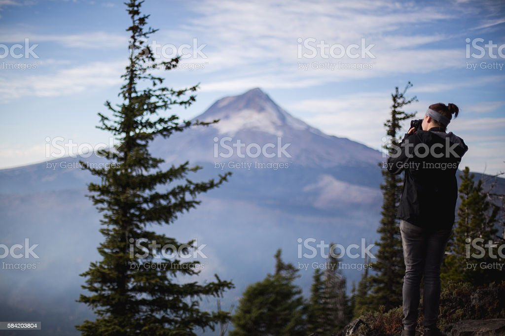 Photographer Taking a Picture of Mount Hood in Oregon stock photo