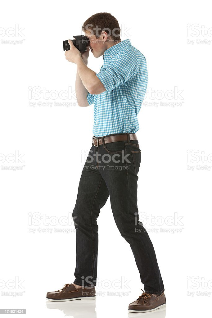 Photographer taking a picture with camera royalty-free stock photo