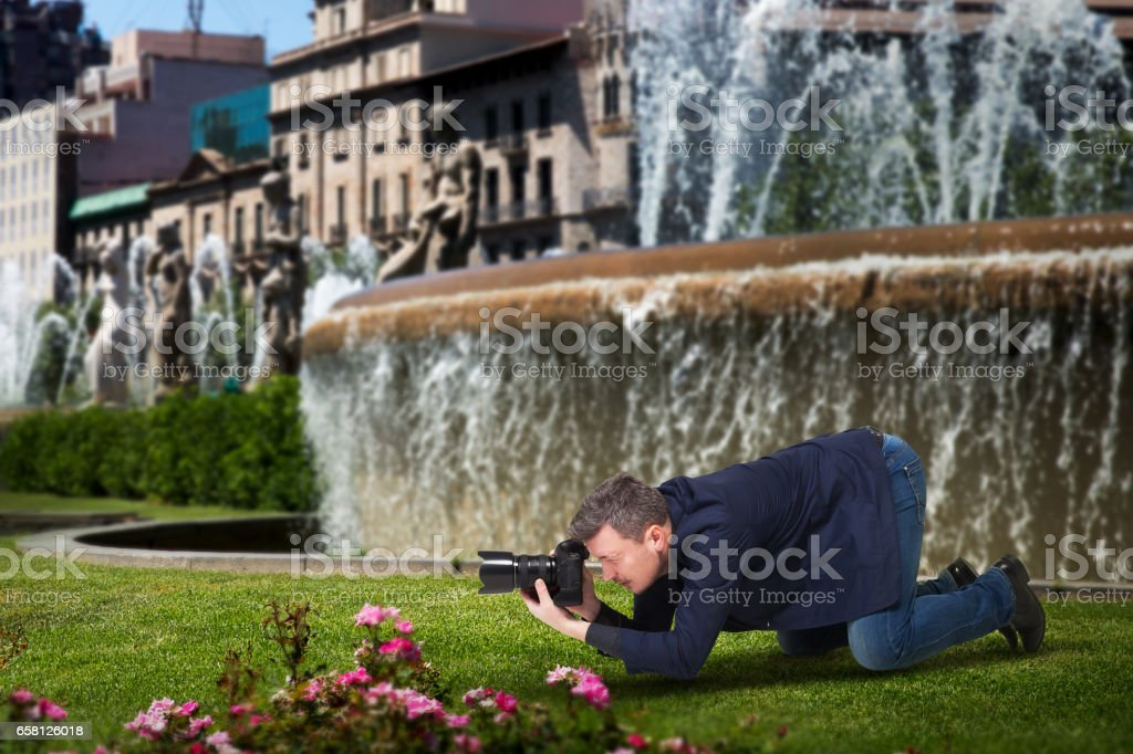 Photographer taking macro picture of flowers stock photo