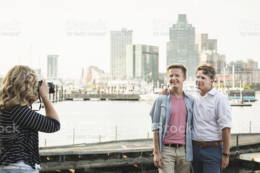 Photographer Taking Photo of Male Couple stock photo