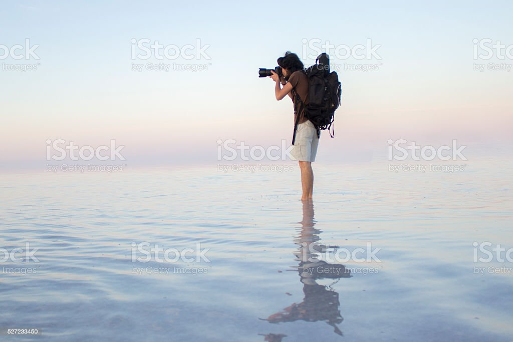 Photographer taking photo on water stock photo