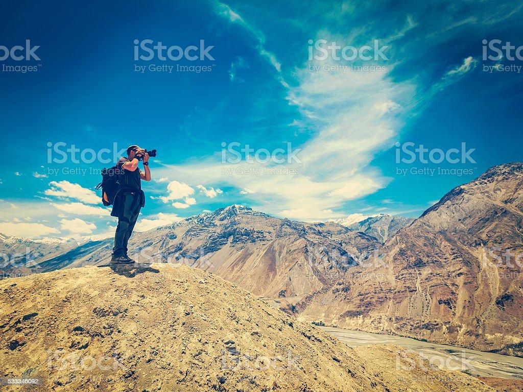 Photographer taking photos in Himalayas stock photo