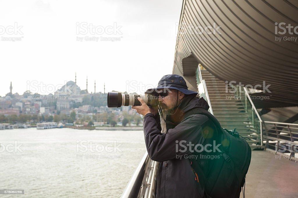 Photographer taking photos in Istanbul, Turkey stock photo