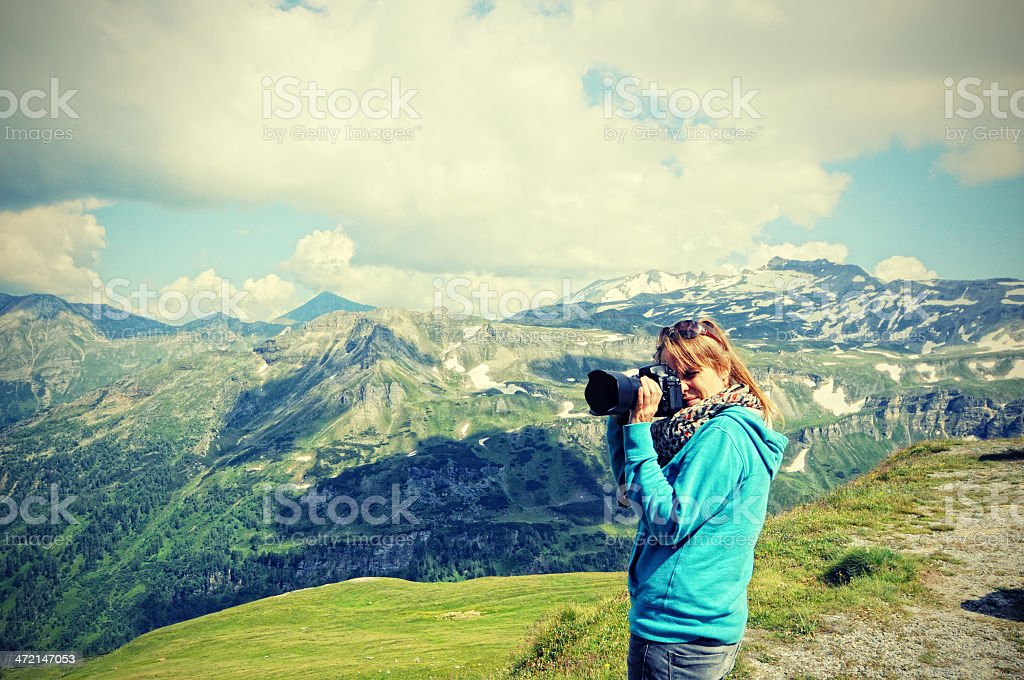 photographer taking pics of Grossglockner mountain area stock photo