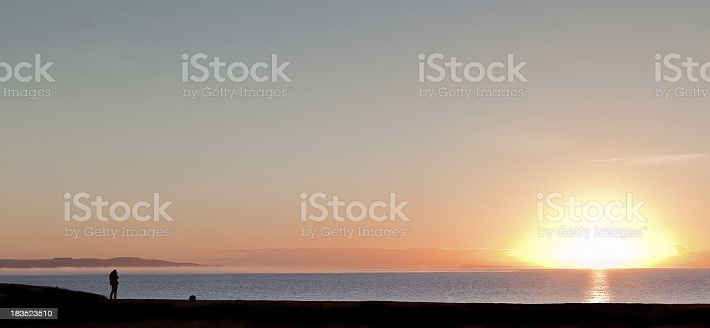 Photographer taking pictures at sunrise royalty-free stock photo