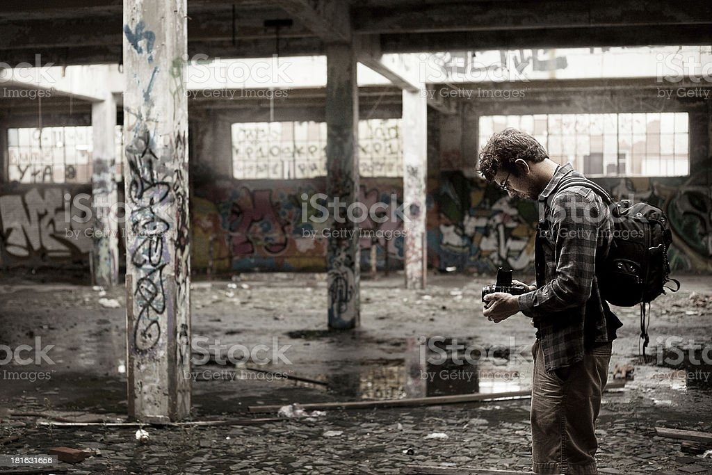Photographer Taking Pictures of an abandonned Building royalty-free stock photo