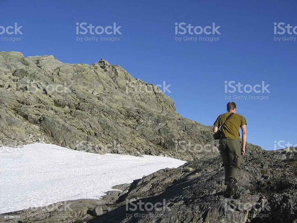 Photographer tracking in mountains royalty-free stock photo