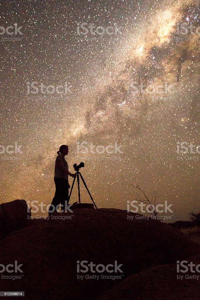 Photographer under the milky way stock photo