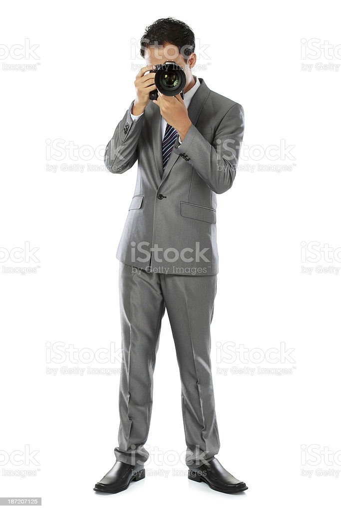 photographer using dslr camera royalty-free stock photo