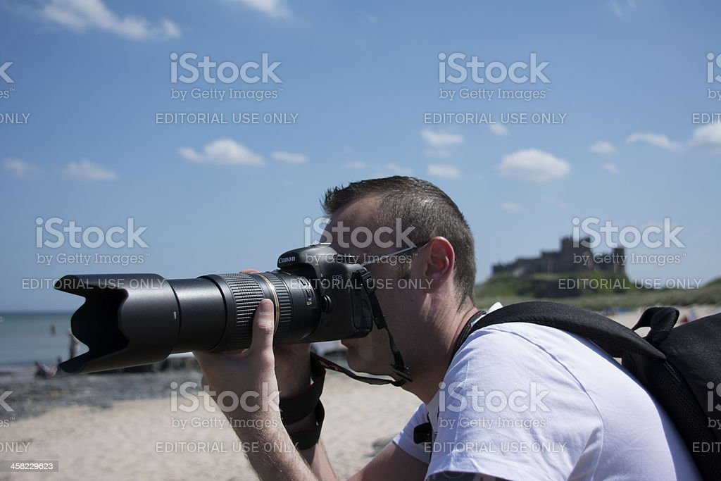 Photographer using the new Canon Eos 7D stock photo