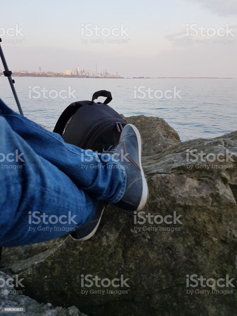 Photographer waiting to shoot at right time in front of Toronto Skyline stock photo
