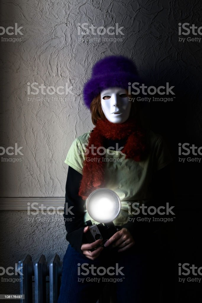 Photographer Wearing Mask Taking Photograph with Flash stock photo