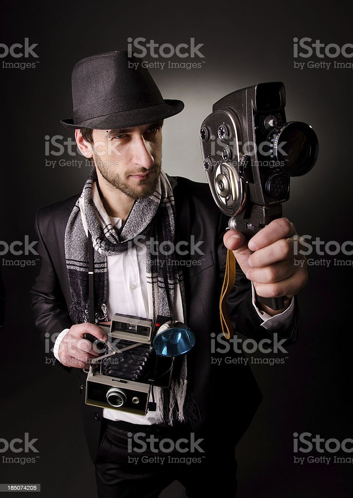Photographer with a vintage camera royalty-free stock photo