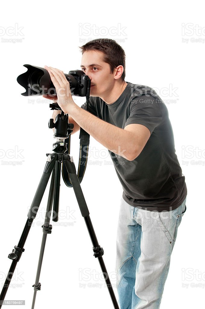 Photographer with camera and tripod, isolated on white royalty-free stock photo