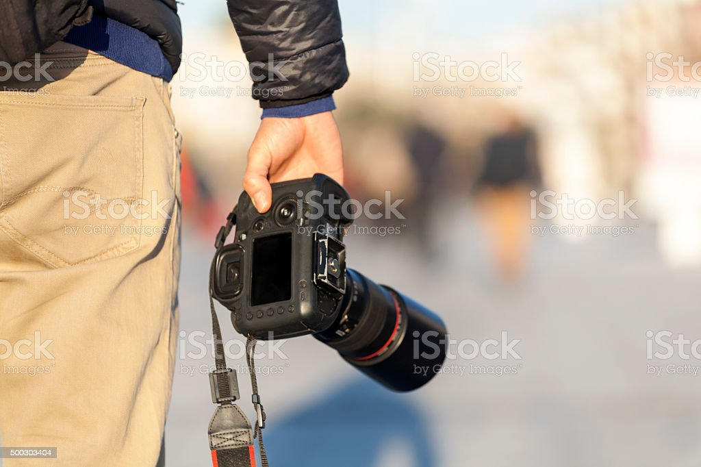 photographer with camera from back stock photo