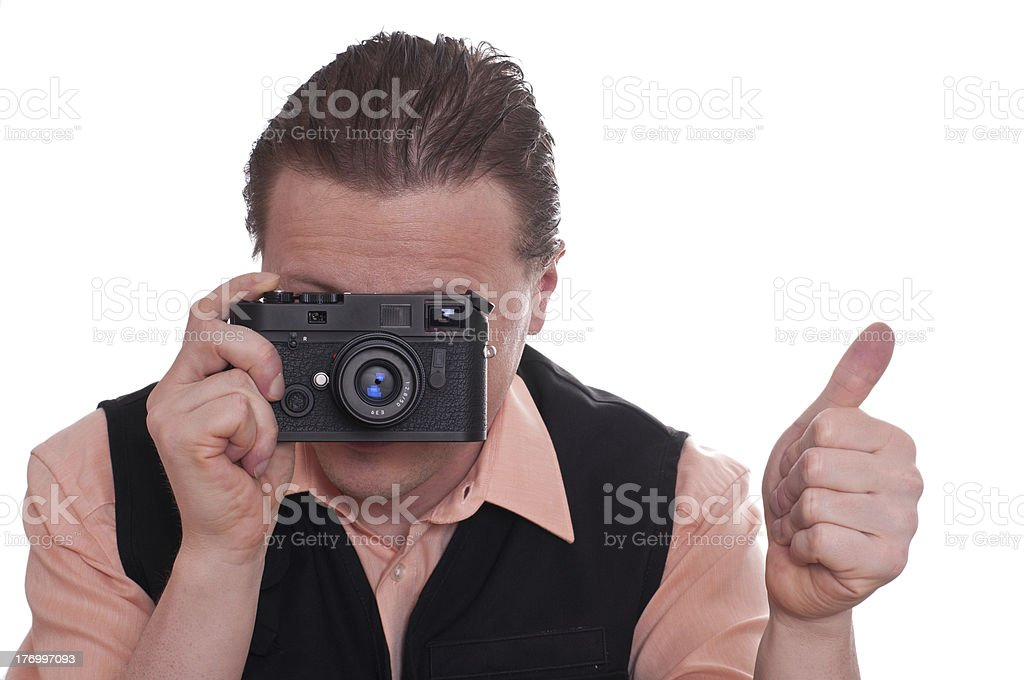 Photographer with camera is holding up his thumb stock photo