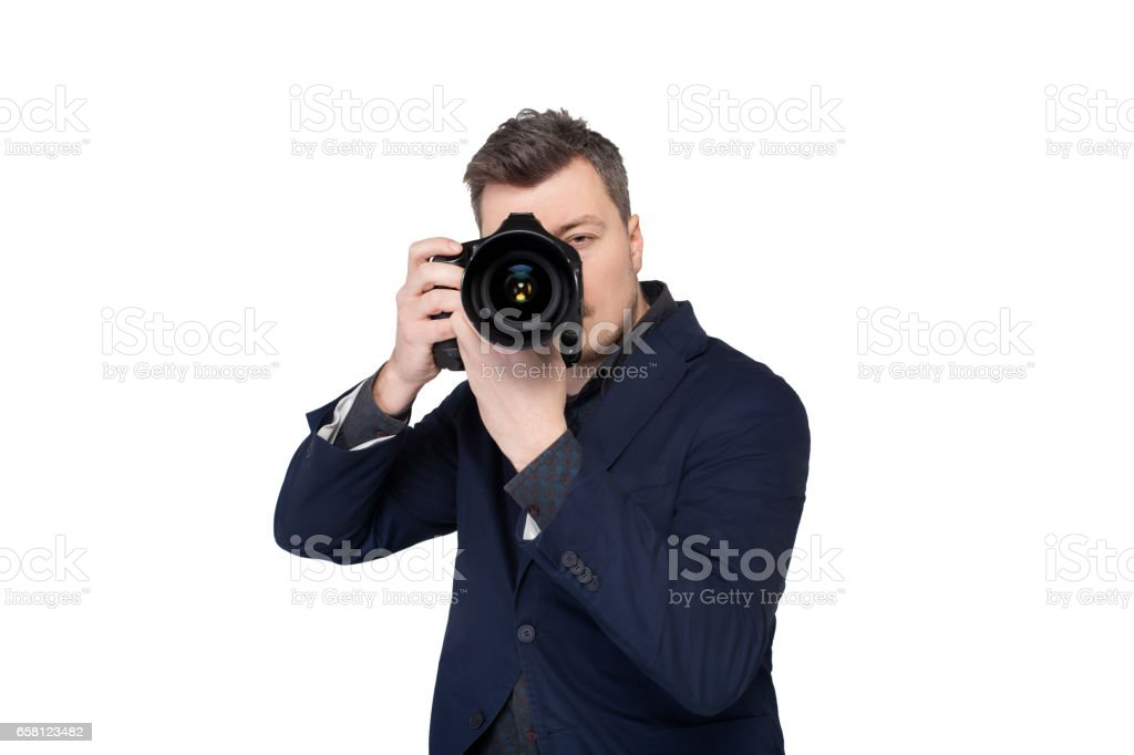 Photographer with digital camera taking picture stock photo