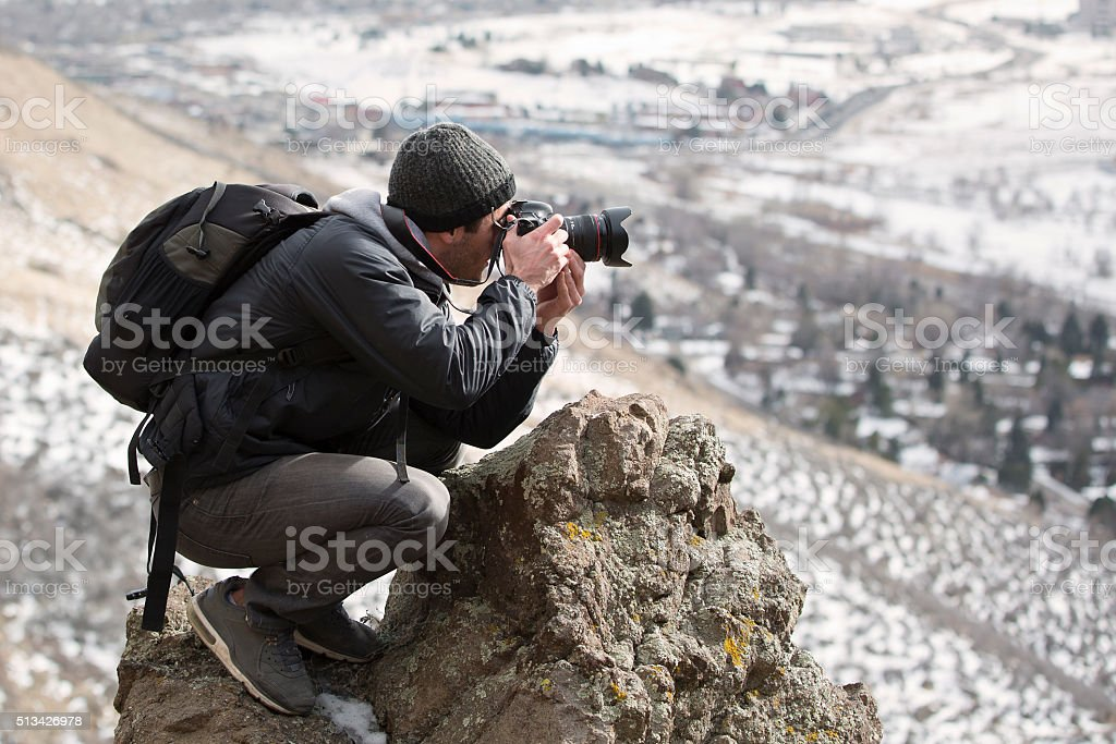 Photographer with his camera stock photo