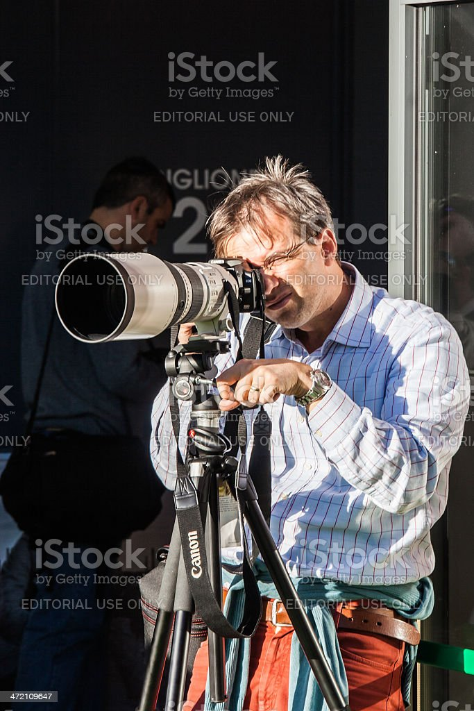Photographer with large telephoto lens stock photo