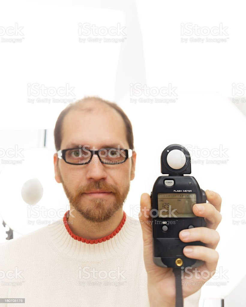 Photographer with light meter stock photo