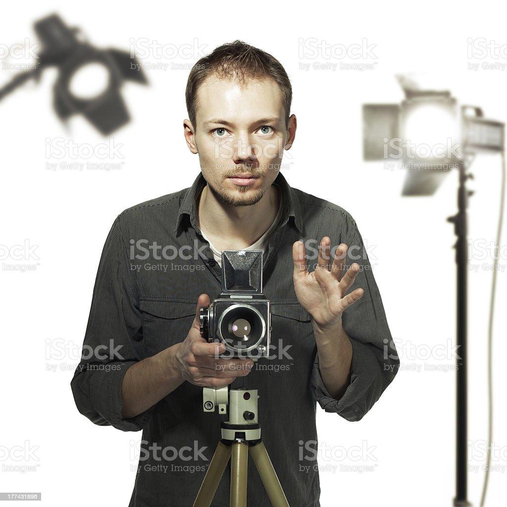 Photographer with retro camera in studio stock photo