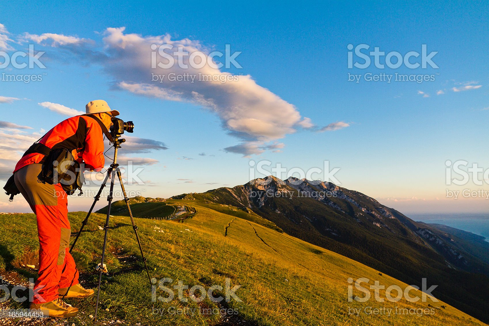 Photographer with tripod royalty-free stock photo