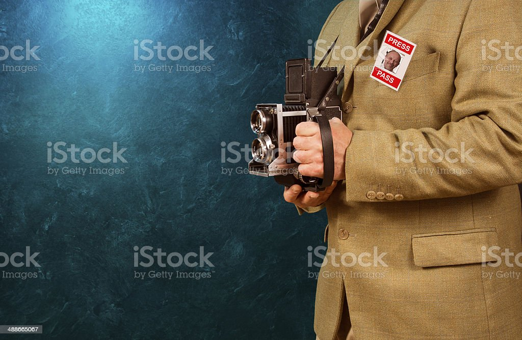 Photographer with vintage camera stock photo