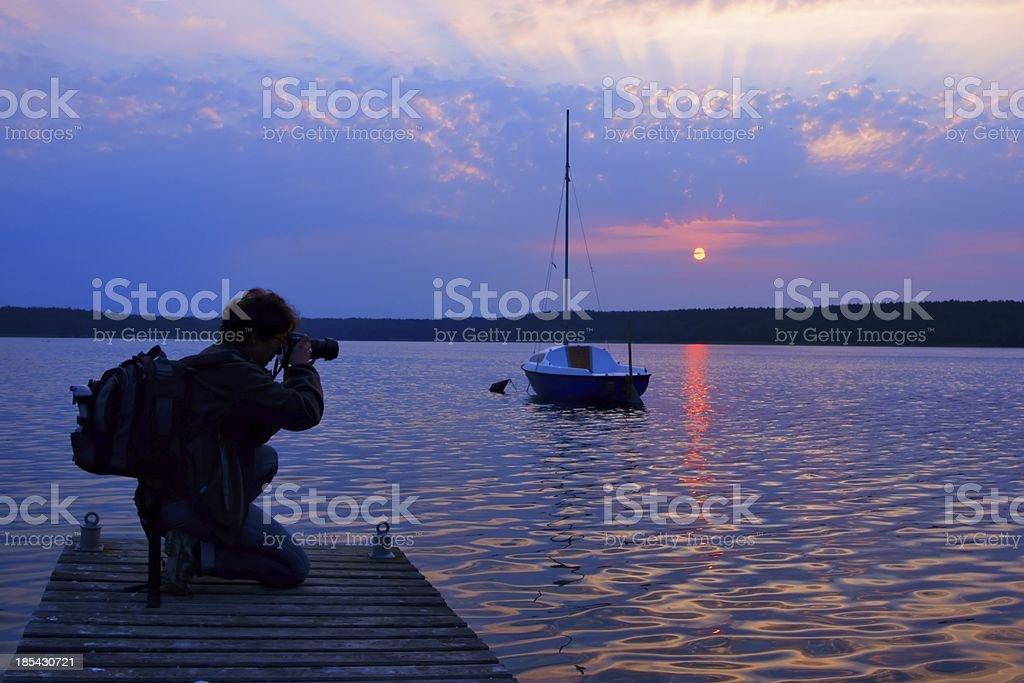 Photographer, woman photographing sunrise royalty-free stock photo