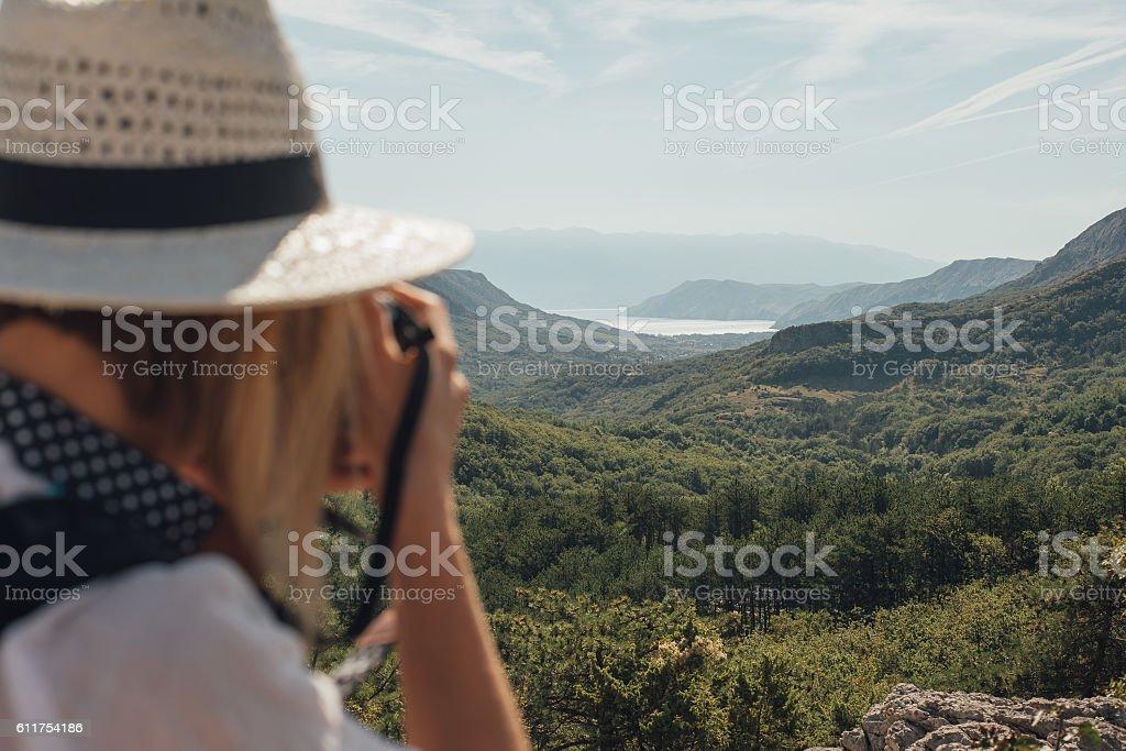 Photographer woman taking photo outdoor stock photo