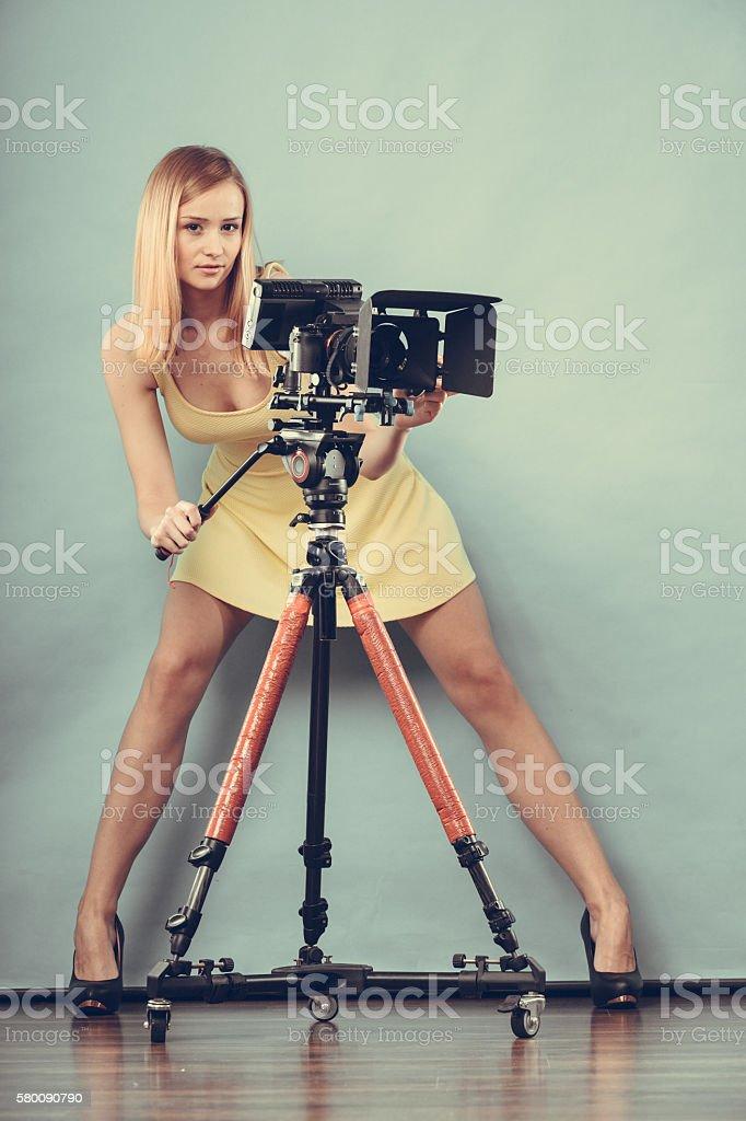 Photographer woman with camera taking photos stock photo